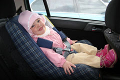 Baby in car. Chair Stock Photos