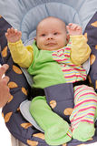 Baby in car child armchair Royalty Free Stock Image