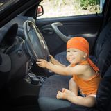 Baby in a car Stock Image