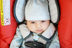 Baby in a car seat. Baby rides in an infant car seat with side impact Stock Photography