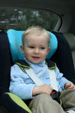 Baby in car seat. 18 months old baby boy in car safety seat Stock Images