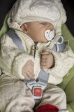 Baby in car seat. Sleeping baby in car seat Royalty Free Stock Photography