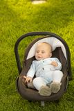 Baby in car seat on grass Stock Photo