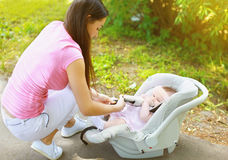 Baby car seat, mom and child. Car Royalty Free Stock Photo