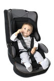 Baby in car seat over white. Little child on vehicle car safety royalty free stock photo