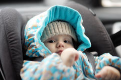 Baby in car seat. Portrait of little baby in car seat Royalty Free Stock Images
