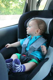 Baby in car seat for safety. Looking outside Stock Photos