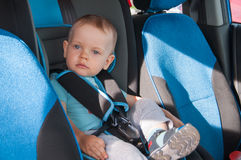 Baby in car seat for safety, looking outside Royalty Free Stock Photo