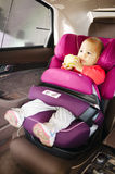 Baby car seat for safety. Luxury baby car seat for safety with happy child Stock Image
