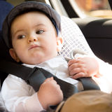 Baby in car seat for safety Stock Photos