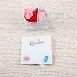 Baby card - baby shower theme. Pram full of Royalty Free Stock Photo