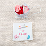 Baby card - Its a girl theme. Pram full of flowers Stock Image