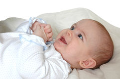 Baby Care. A baby lays on her back as her mom changes her diaper. The care of children Royalty Free Stock Images