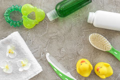 Baby care with bath set, ducklings and towel on gray background top view mockup Royalty Free Stock Images