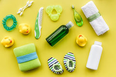 Baby care with bath set, ducklings and towel on yellow background top view pattern Royalty Free Stock Image
