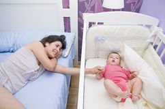 Baby care in bedroom Royalty Free Stock Photo