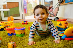 Baby on carpet Royalty Free Stock Image