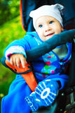 Baby in the carriage Stock Images
