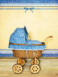Baby carriage. Poster/ Card with vintage baby wicker carriage for boy in room stock images