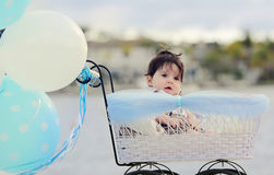 Baby in carriage Stock Images