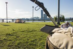 A baby carriage and a camping tent on green grass at Hangang Park, Seoul, South Korea stock photos