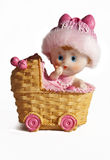 Baby Carriage Ceramic Toy. A Toy Of Baby In Bed Carriage Royalty Free Stock Image