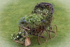 Baby carriage decorated with flowering Stock Images