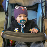 Baby in carriage. Little baby in carriage , boy , the younger than one year old stock image