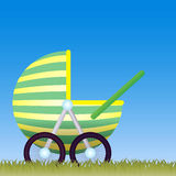 Baby Carriage on the meadow Stock Photos