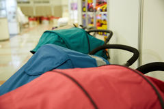 Baby carriages of different models and colors Royalty Free Stock Photo