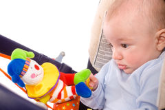 Baby carrier and toys Royalty Free Stock Photography