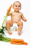 The baby with carrot Royalty Free Stock Photography