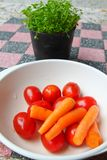 Baby carrot and fresh tomato Royalty Free Stock Photography