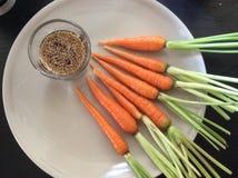Baby carrot with sho yu. Baby carrots with shu yu sauce orange Stock Photo