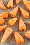 Baby carrots on burlap background Royalty Free Stock Photo