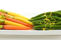 Baby carrots and green beans Stock Photography