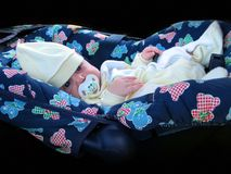 Baby in carseat. Little beautiful baby in comfortable blu carseat Stock Image