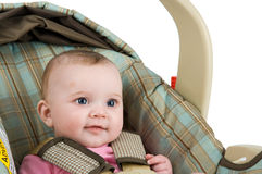 Baby In a Carseat. A baby girl in a carseat on a white background Stock Photo