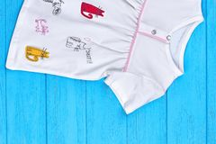 Baby cartoon cat pure cotton dress. Infant girl short sleeve cat print cotton dress on blue wooden background close up royalty free stock images