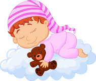 Baby cartoon sleeping on the cloud Stock Images