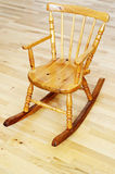 Baby carved wooden rocking chair Royalty Free Stock Photo