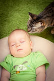 Baby and a cat royalty free stock photos