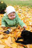 Baby and cat stock images