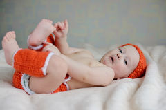 Baby catching own legs Royalty Free Stock Photo