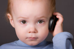 Baby with cell phone Stock Photo