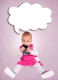Baby and cell phone Royalty Free Stock Image