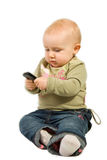 Baby with cellphone Stock Images