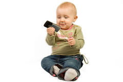 Baby with cellphone Stock Photo