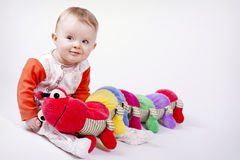 Baby with the centipede Royalty Free Stock Photography