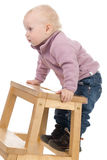 Baby on a chair. Surprised little girl on a chair Stock Photography